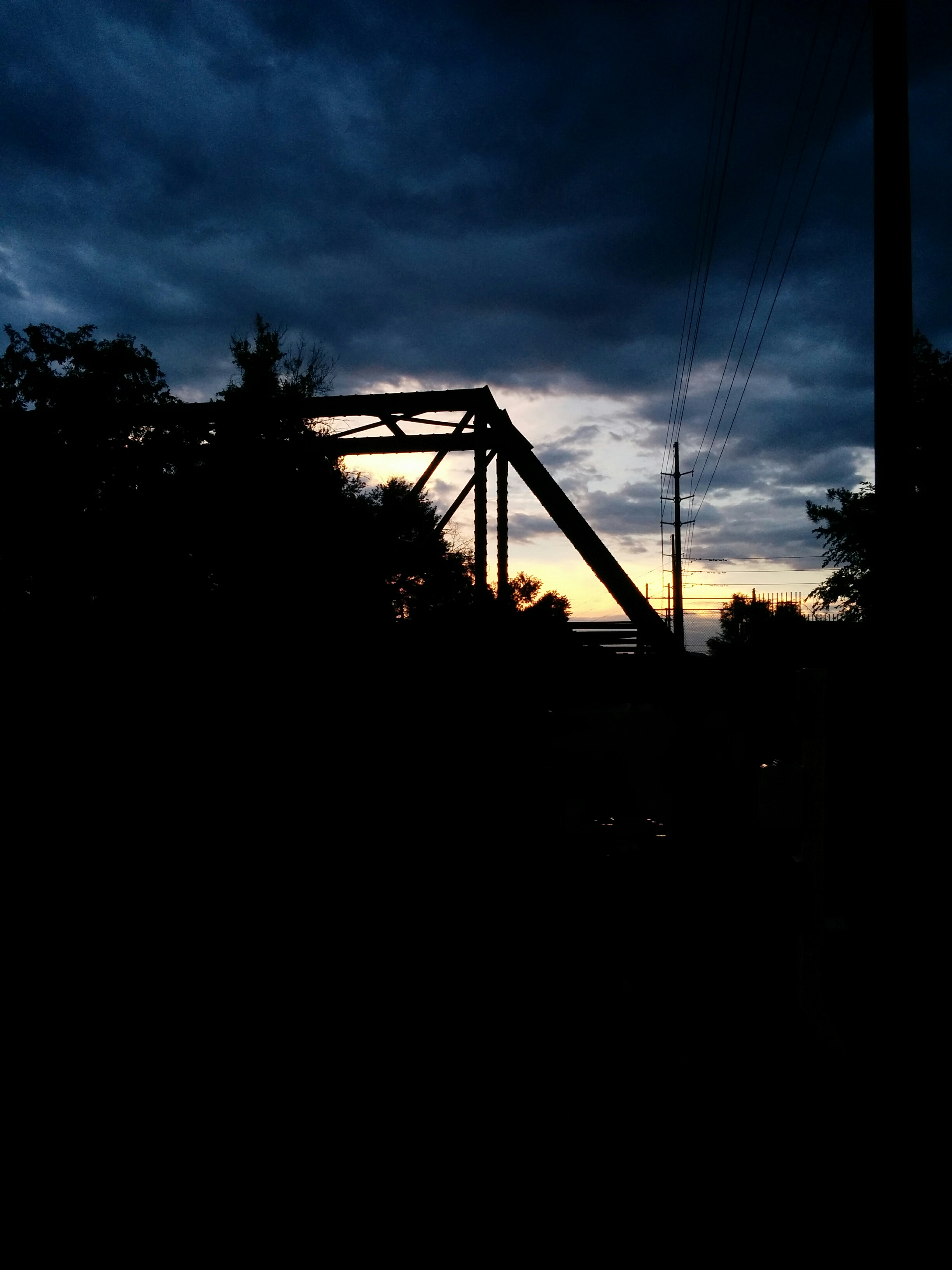 A nice abandoned railway bridge in front of the sunset.