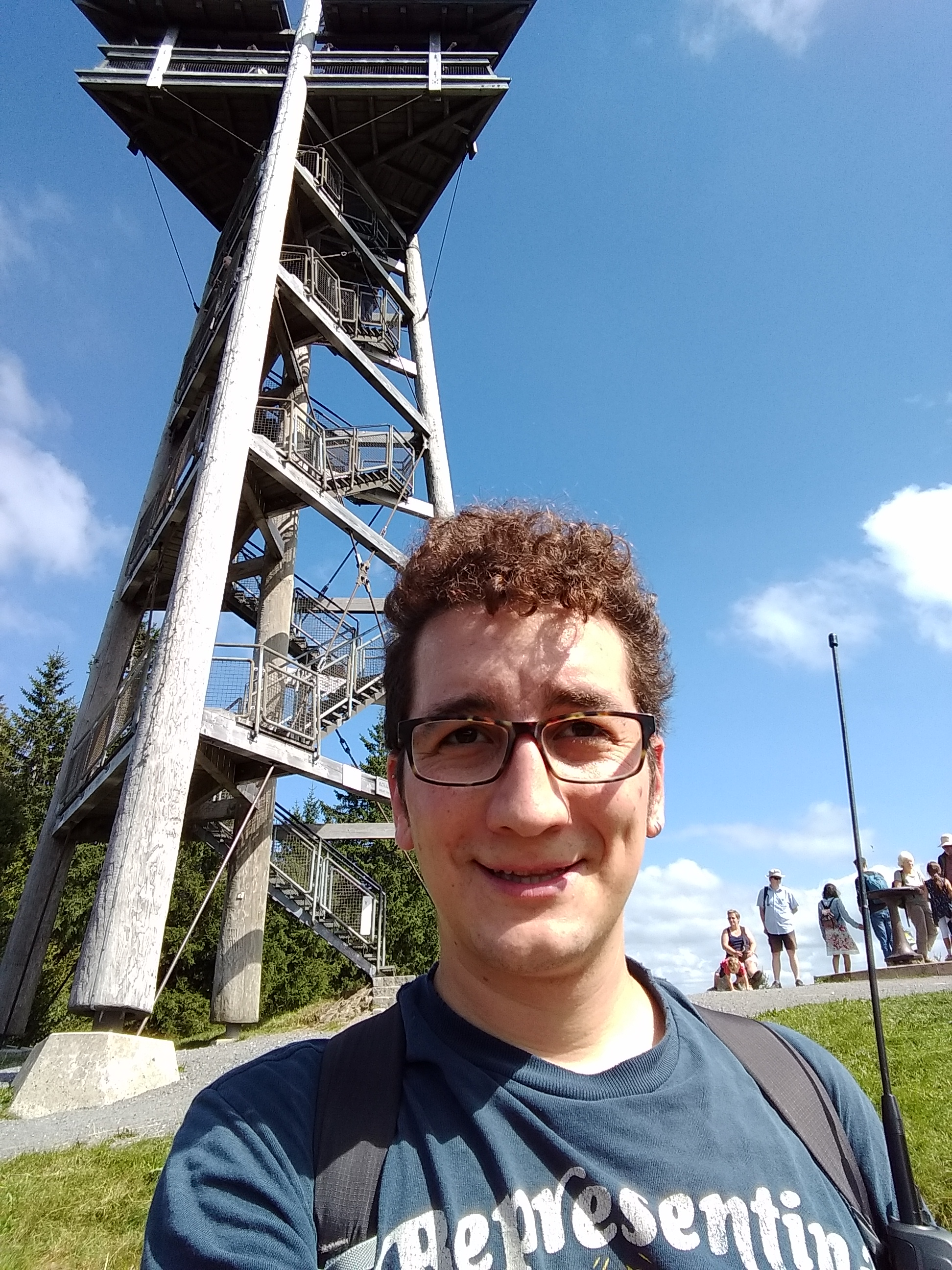 Selfie on Schauinsland with the observation tower visible in the background.
